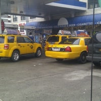Photo taken at Mobil by Zanda K. on 1/12/2013