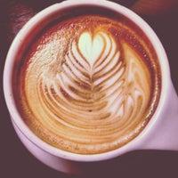 Photo taken at Atomic Coffee by Jake F. on 3/17/2013