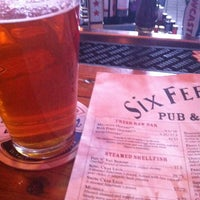 Photo taken at Six Feet Under Pub & Fish House by Matt G. on 3/25/2013