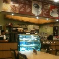 Photo taken at Sérye Café Filipino by Jason G. on 1/31/2013