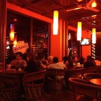 Photo taken at Banana's Café by Luis M. on 12/3/2012