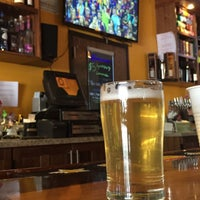 Photo taken at The Library Sports Grill and Brewery by Jesse H. on 6/6/2015
