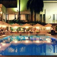 Photo taken at La piscine de l'Hotel Memling by JaHyun Y. on 3/11/2013