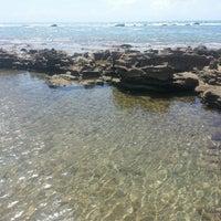 Photo taken at Praia Barra de São Miguel by Lore F. on 2/18/2013