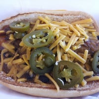 Photo taken at Delia's Chicken Sausage Stand by Joseph B. on 2/8/2013