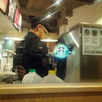 Photo taken at Starbucks by Fabrice V. on 12/30/2012