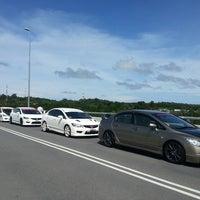 Photo taken at Jambatan Kuala Penyu by albireo endratno b. on 12/14/2013