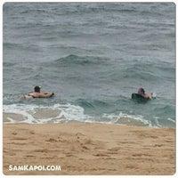 Photo taken at Makaha Beach Park by Sam K. on 5/5/2013