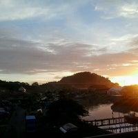 Photo taken at Jembatan Siti Nurbaya by Rhe X. on 6/7/2013