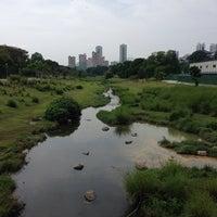 Photo taken at Bishan - Ang Mo Kio Park by Sunny B. on 8/2/2014