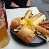 Photo taken at 100 montaditos by Cansu T. on 3/20/2014