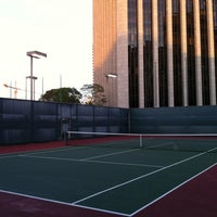 Photo taken at World Trade Center Rooftop Tennis courts by Raymond Y. on 4/10/2012