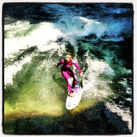 Photo taken at Eisbach Wave by Charlie J. on 7/25/2013