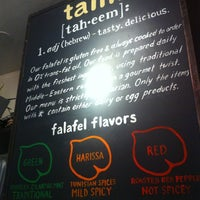 Photo taken at Taïm Falafel and Smoothie Bar by Julia M. on 8/1/2013