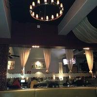 Photo taken at Plum Restaurant Bar & Lounge by Lenora R. on 2/23/2013