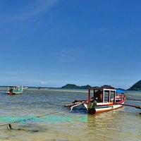 Photo taken at Pantai Pasir Putih by Diana S. on 6/23/2016