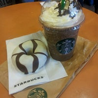 Photo taken at Starbucks by Candy N. on 3/7/2013