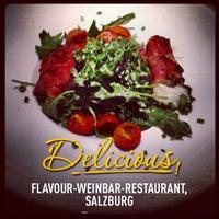 Photo taken at FLAVOUR Weinbar Restaurant by Peter B. on 7/23/2013