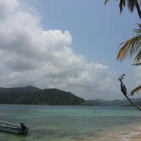Photo taken at Isla Grande Colon by Jessamyn N. on 4/10/2013