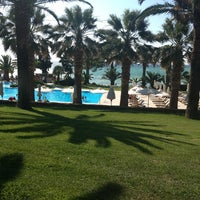 Photo taken at Sani Beach Club by Luka P. on 7/1/2013