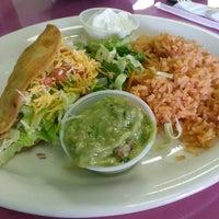 Photo taken at Mangos Mexican Café by Alyssa V. on 4/6/2013