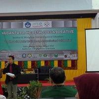 Photo taken at Auditorium FKIP UNSYIAH by puan W. on 5/31/2014