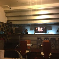 Photo taken at Azafrán Restaurant & Bar by Jose A. on 2/4/2013