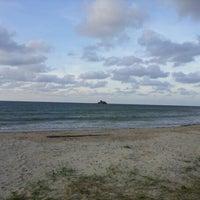 Photo taken at Layang-layangan Beach by Sarah I. on 12/2/2012