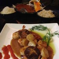 Photo taken at Sushi Damo by Sara R. on 2/17/2013
