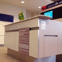 Photo taken at Gate A7 by Sonia V. on 12/9/2012