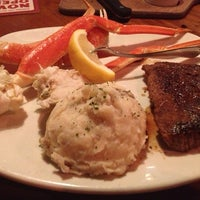 Photo taken at Outback Steakhouse by Deondriea C. on 7/14/2013