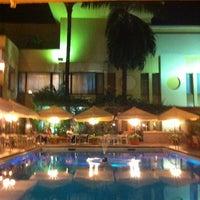 Photo taken at La piscine de l'Hotel Memling by murielle S. on 9/28/2013