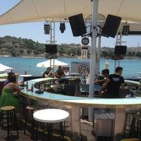 Photo taken at KafePi Beach Club by Semih K. on 7/7/2013