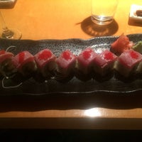 Photo taken at Sushi Cafe by Laura G. on 3/9/2014