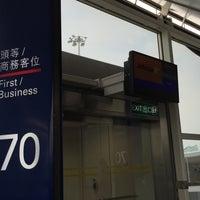 Photo taken at Gate 70 by Shigeharu S. on 10/19/2015