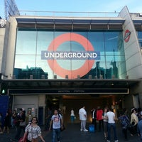 Photo taken at Brixton London Underground Station by Christian D. on 6/30/2013