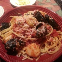 Photo taken at Carrabba's Italian Grill by Ellen S. on 7/4/2013