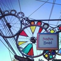 Photo taken at PataPata Hostel by Thiago R. on 3/14/2013