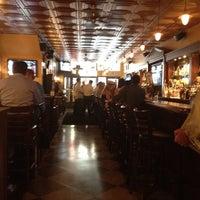 Photo taken at Mulligan's Pub by Anthony J. on 8/23/2012