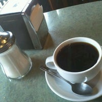 Photo taken at Caffe Puccini by Patrick M. on 3/2/2012