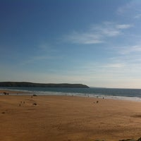 Photo taken at Woolacombe Beach by Sarah E. on 6/2/2013