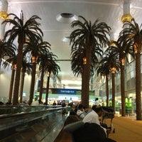Photo taken at Dubai International Airport (DXB) by Asya A. on 6/1/2013