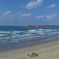 Photo taken at Playa de Salinas / San Juan de Nieva by Andrea S. on 4/6/2013