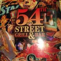 Photo taken at 54th Street Grill & Bar by Isabela S. on 4/21/2013