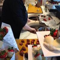Photo taken at Godiva Chocolatier by Jayson M. on 3/8/2014