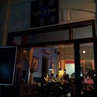 Photo taken at Puku Café & Sports Bar by Pearl N. on 5/16/2012