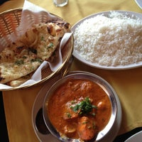 Photo taken at Taj Mahal Grill by Emily M. on 5/9/2013