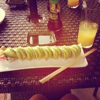 Photo taken at Manu's Tapas Bar & Sushi Lounge by Natalia P. on 3/28/2013