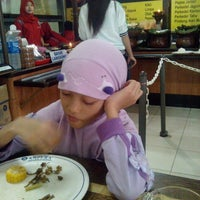 Photo taken at Warung Nasi AMPERA by Wisnu R. on 6/26/2013