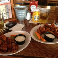 Photo taken at Teakwoods Tavern & Grill by Trish V. on 6/1/2013